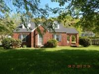 Nice 1 1/2 story brick home with 4 bedrooms, 2 bath,