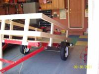 This is a great new 4' x 8' Tilting trailer. Pulls a