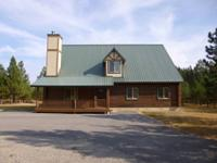 Chalet Style Log House available for sale situated at