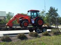 Kubota L 4240 42 HP 4X4 Cab Tractor with front loader.