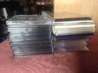 43 CD cases. Black, white, clear, and a few green and