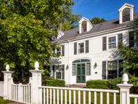 This elegant and stately historic Federal residence has