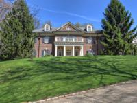 This six bedroom, elegant home is nestled in a