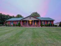 This all brick ranch is simply gorgeous! A luxurious