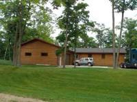 half log sided lake home with 12x30 deck, 26x40 heated