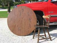 44 in round table, includes a 12in leaf and 4 chairs.