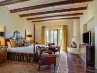 This elegant 3530 square foot, pueblo style home of