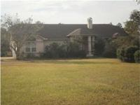Lovely stucco home sitting on almost four acres of land