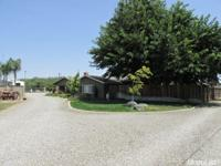 Beautiful home situated on 1 acre parcel. Move-in