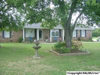This brick home sits on 11.6 acres. Recent updates are