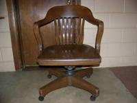 Antique oak desk chair. It?s real heavy and sturdy with