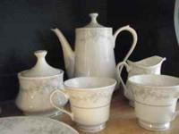 45 piece fine china 8 place seting set bought in Hong