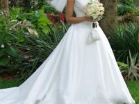 Beautiful classic ivory organza gown with intricate