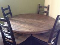 Selling our solid wood round table. It's just a year