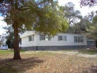 REMODELED DOUBLE WIDE SITTING ON JUST UNDER 1 ACRE,