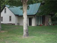 Nice house w/great farm behind it. Conv. to I-40, just