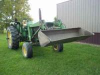 Tractor has a JD148 loader,2400 hrs. and runs great.Any