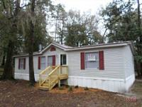 Lovable 3 room 2 bath dual wide on over 1/4 acre in