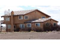 Nice 2-story stucco near Center Colorado on 5.66 acres.