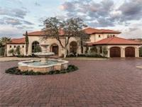 Privately gated showcase home in the desirable Seven