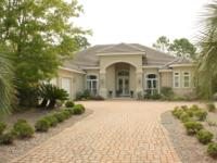 Stunning custom home, situated on a lovely corner lot