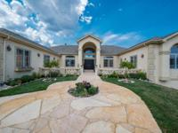 Beautiful custom ranch home in Bell Mountain Ranch with