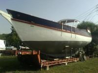 Please call owner K.C. at . Boat is in Venice, Florida.