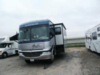 This 2008 34' Class A Fleetwood Fiesta LX has two large