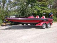 2009 Ranger Z520 (single console). Tri-color hull (red