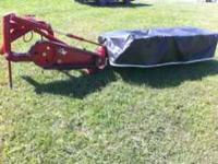 Disc mower in real good shape very clean tarp in great