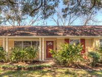 Bellaire Ranch style home with two Gorgeous live Oak