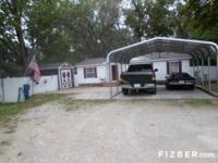 Home, carport and storage bldgs., fenced yard, nice