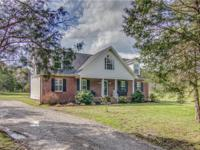 REMARKABLE home in the country w/ the privacy you've