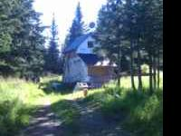2 acres with cabin out side of homer. Cabin has power,