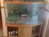 48 gallon aquarium with oak stand/cabinet. Comes with