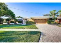As you enter this fabulous home via the lovely gated