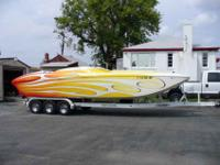 You are looking at a 2005 Ultra Custom Boats, 27 Shadow