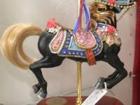 This handsome carousel horse is black with red roses