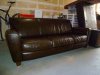 Italian leather Sofa, by NATUZZI. 84in wide x 34in deep