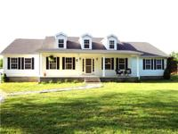 This Exquisite Home On 2.6 Acres Features Hand Scraped