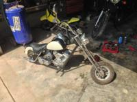 Small chopper frame 2-stroke motorcycle. Rated for 200