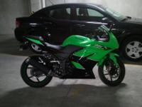 Green 2011 Kawasaki Ninja 250 for sale. Great