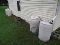 4 55 gallon food-grade drums. Comes with hoses, clamps,