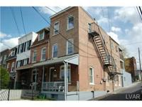 REDUCED PRICE on this renovated 3 unit conveniently