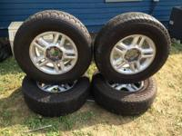 I have for sell 4 ford rims with brand new tires. As