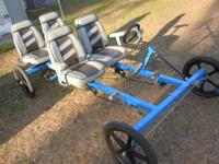 4 wheel bicycle built for four people. The two in the