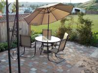4 Person glass top patio table (round) with 4 nylon