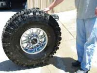 Here are 4 Super Swamper tires, size 38.5 x 11- 16 LT