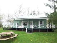 This 4 bedroom cottage sleeps 8-12 includes gas grill,