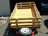 Folding utility trailer has plywood deck, interlocking